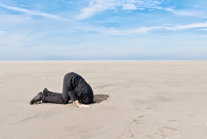 Man-with-head-in-ground-from-istock