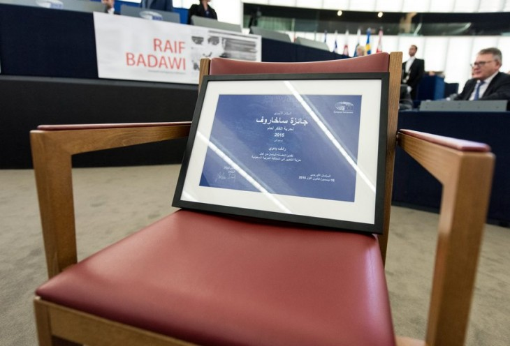 epa05070936 The Sakharov Prize for jailed Saudi blogger Raif Badawi stands on an empty chair in the European Parliament in Strasbourg, France, 16 December 2015. Raif Badawi, who is serving a prison term in Saudi Arabia for allegedly insulting Islam, was awarded the European Parliament's Sakharov Prize for Freedom of Thought on 16 December, due to exceptional courage which had earned him 'one of his country's most gruesome punishments,' parliament President Martin Schulz has said.  EPA/PATRICK SEEGER