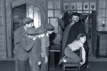 schoolboy-being-caned-by-strict-teacher